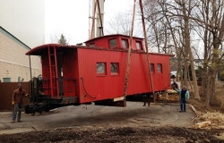 Picture Of A Caboose Secured With Certified Welding Services - C & D Rigging, Inc.